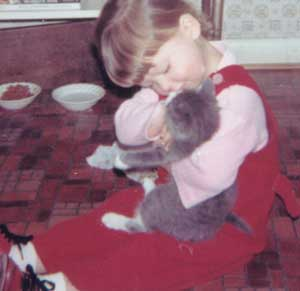toddler with kitten